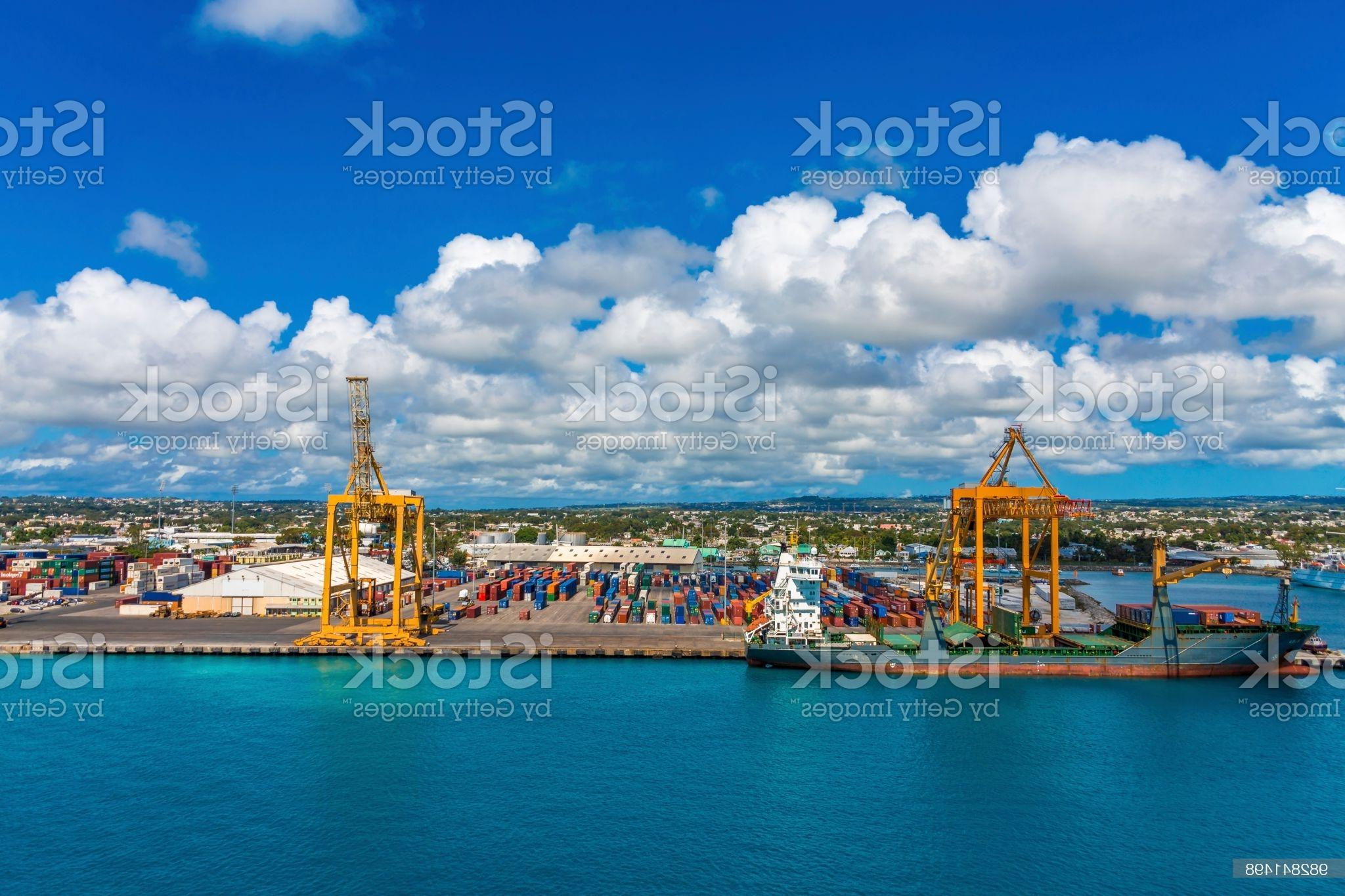 Freighter and Containers in Barbados Image Royalty Free